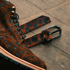 The Stitched Belt in Lynx paired with the boot