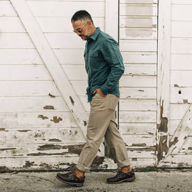 our fit model wearing The Camp Pant in Ash Boss Duck—walking left