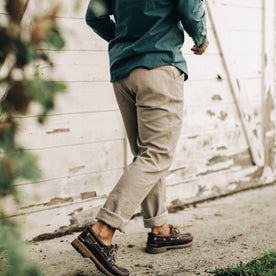our fit model wearing The Camp Pant in Ash Boss Duck—walking right