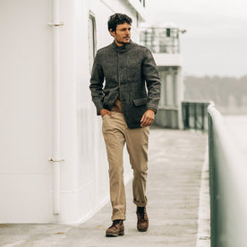 our fit model wearing The Camp Pant in Khaki Reverse Sateen—walking on a ferry