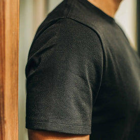 our fit model wearing The Heavy Bag Tee in Black—cropped shot of shoulder