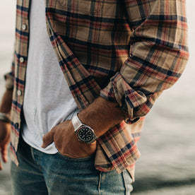 our fit model wearing The Jack in Brushed Khaki Plaid—cropped shot of cuffed sleeve