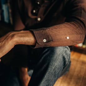 our fit model relaxing in The Jack in Brushed Rust Oxford—cropped shot of sleeve