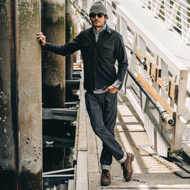 our fit model wearing The Slim Everyday Jean—standing on a dock looking ahead
