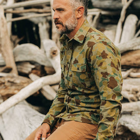 our fit model wearing The Yosemite Shirt in Arid Camo—cropped shot of left shoulder and chest