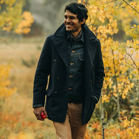 fit model wearing The Mendocino Peacoat in Navy Wool, smiling and walking
