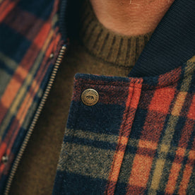 fit model wearing The Bomber Jacket in Navy Plaid Wool, button detail