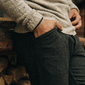 fit model wearing The Camp Pant in Dark Moss Wool, hand in pocket