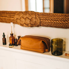 textural material shot of The Dopp Kit in Saddle Tan in bathroom