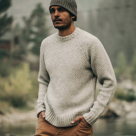 fit model wearing The Fisherman Sweater in Heather Ash, hands in pockets