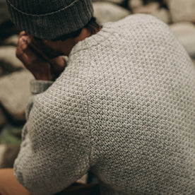 fit model wearing The Fisherman Sweater in Heather Ash, back shot