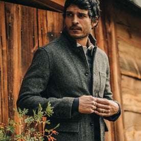 fit model wearing The Gibson Jacket in Charcoal Birdseye Wool, looking left