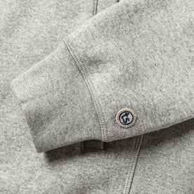 material shot of The Heavy Bag Bomber in Heather Grey Fleece's cuff with TS logo embroidery