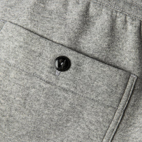 material shot of back pocket and horn button closeup of The Heavy Bag Pant in Heather Grey Fleece