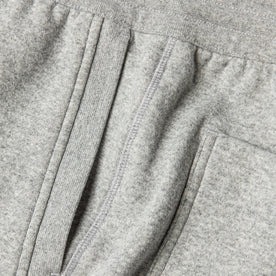 material shot of The Heavy Bag Pant in Heather Grey Fleece's side seam showing diversity of knit stitching and ribbing details throughout