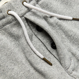 material shot of hidden button fly of The Heavy Bag Short in Heather Grey Fleece