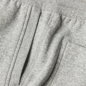 material shot of The Heavy Bag Short in Heather Grey Fleece showing diversity of stitching along the side seam with the ribbing detailing of the diagonal pockets