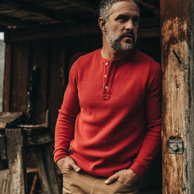 our fit model wearing The Heavy Bag Waffle Henley in Cardinal—LOOKING RIGHT