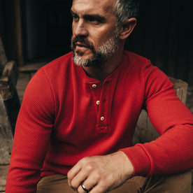 The Heavy Bag Waffle Henley in Cardinal—looking left