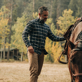 fit model wearing The Jack in Brushed Green Plaid, petting horse