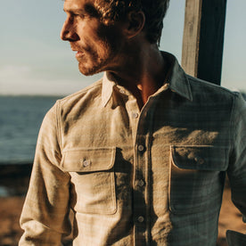 fit model wearing The Ledge Shirt in Sand Plaid, looking left