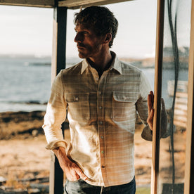 fit model wearing The Ledge Shirt in Sand Plaid, looking left, hand in pocket