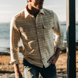 fit model wearing The Ledge Shirt in Sand Plaid, looking right, cropped shot nose down