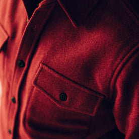 our fit model wearing The Maritime Shirt Jacket in Clifford Red—cropped shot of chest