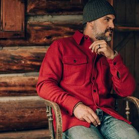 our fit model wearing The Maritime Shirt Jacket in Clifford Red—sitting, looking right
