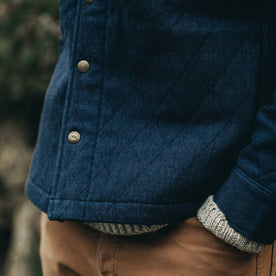 fit model wearing The Quilted Jacket in Indigo Boss Duck, hands in pockets