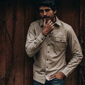 fit model wearing The Yosemite Shirt in Oat Donegal—standing near barn