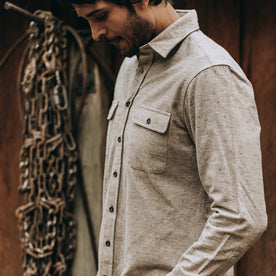 fit model wearing The Yosemite Shirt in Oat Donegal—looking down