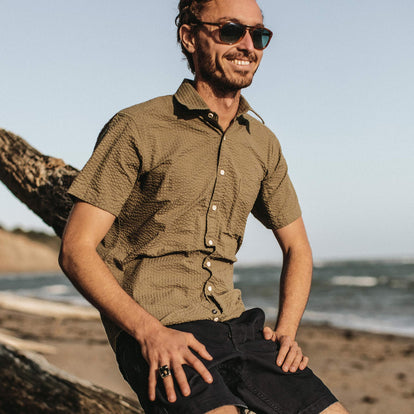 On a windy day our fit model wears a Taylor Stitch shirt