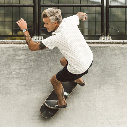 Our fit model skateboarding in The Heavy Bag Tee in Natural Stripe