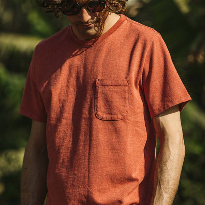 Our fit model wearing The Heavy Bag Tee in Washed Rust.