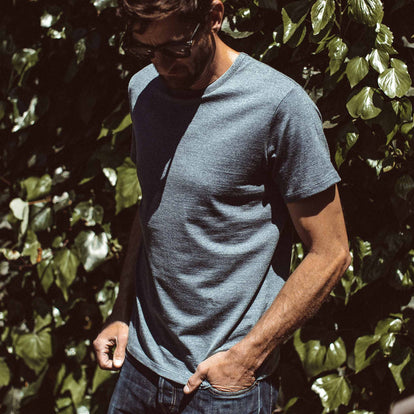 Our fit model wearing The Antoni Tee in Heather Blue by Taylor Stitch.