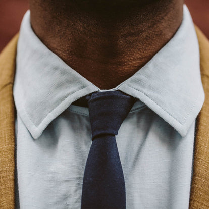 A close up of the fit model in our linen Hyde shirt