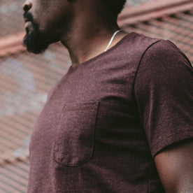 A close up of our fit model wearing the Burgundy Tee