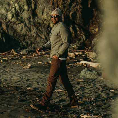 Our fit model on the beach at Sea Ranch wearing the Chore Pant in Timber Boss Duck .