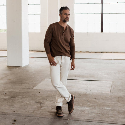 The fit model wearing The Heavy Bag Henley in Fatigue Brown by Taylor Stitch.