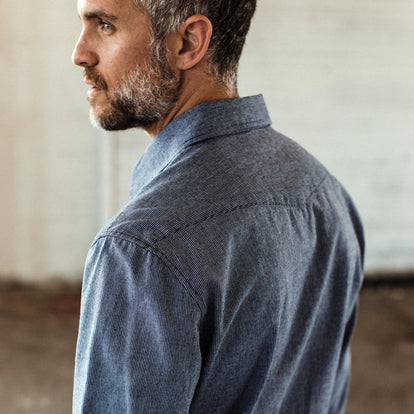 Our fit model wearing The Western Shirt in Indigo Stripe.