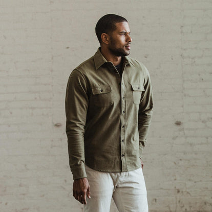 Our fit model wearing The Yosemite Shirt in Dusty Army by Taylor Stitch.