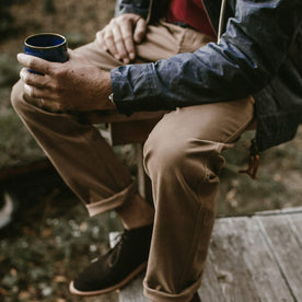 A close up of our fit model in the cord camp pants