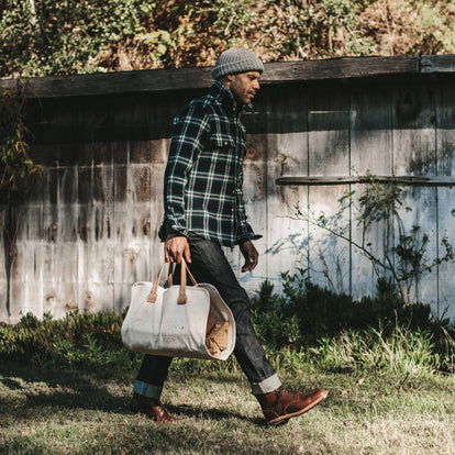 Our fit model wearing The Leeward Shirt while carrying his bag.