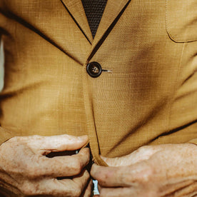 Close up shot of our fit model int the British Khaki suit