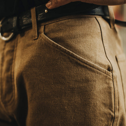 Our fit model wearing The Camp Pant in British Khaki Tuff Duck from Taylor Stitch.