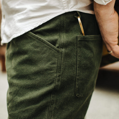 Our fit model wearing The Camp Pant in Dark Olive Tuff Duck from Taylor Stitch.