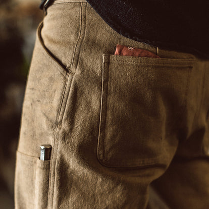 Our fit model wearing The Chore Pant in British Khaki Tuff Duck from Taylor Stitch.