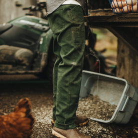 Our fit model wearing The Chore Pant in Dark Olive Tuff Duck from Taylor Stitch.