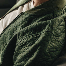 Our fit model wearing The Inverness Bomber in Olive Knit Quilt.